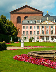 Electorate Palace and its garden with flowers in Trier, Germany