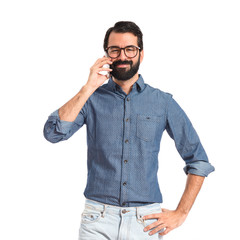 Young hipster man talking to mobile