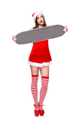 Sexy santa girl holding skatedboard