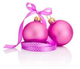 Two Pink Christmas balls with ribbon bow Isolated on white backg