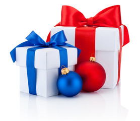 Two white boxs tied red and blue ribbon bow and christmas balls