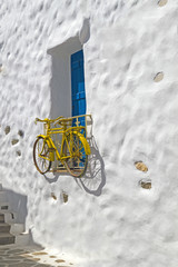 Decorative bicycle hanging from a window in a Greek house on Nax