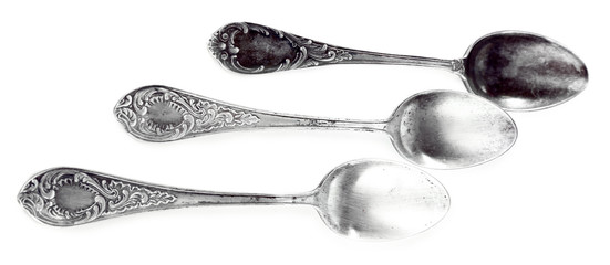 Three teaspoons isolated on white