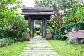 Wooden arched entrance to Thai home