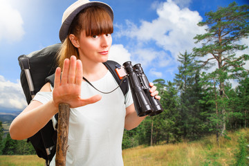 Woman hiker posing. No trespassing.