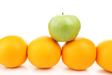 Juicy oranges and green apple, isolated on white