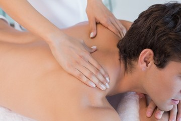 Close up of back massage at spa center