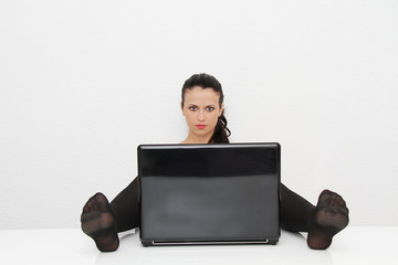 Attractive young woman working on her laptop at home