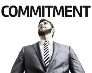 Business man pointing the text: Commitment