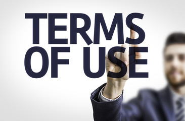Business man pointing the text: Terms of Use