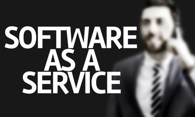 Business man with the text Software as a Service