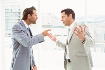 Business colleagues in argument at office