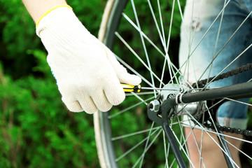 Man repairing his bike, close-up