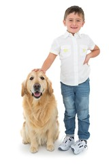 Portrait of smiling boy standing with his dog