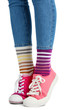 canvas print picture - Female legs in colorful socks and sneakers isolated on white