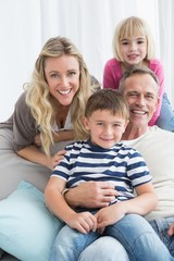 Portrait of a smiling family sitting on sofa