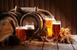Leinwanddruck Bild - Beer barrel with beer glasses on table on wooden background