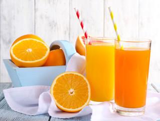 Orange and carrot juice in glasses