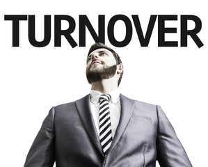 Business man with the text Turnover in a concept image