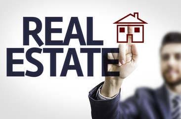 Business man pointing the text: Real Estate