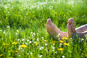 bare feet on spring grass
