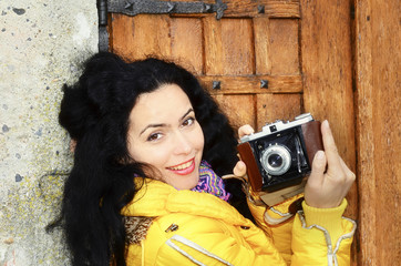 Beautiful woman with old film photo camera collection