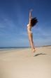 floral bikini woman jumping
