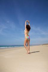 bikini woman stretching