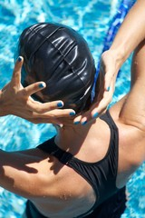 blue polish nails swimmer placing cap