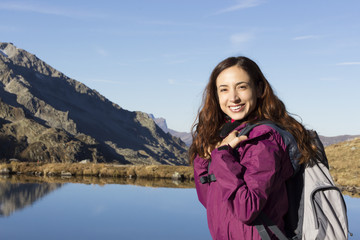 Young hiker woman enjoying nature in autumn