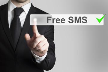 businessman pushing flat touchscreen button free sms