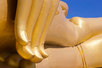 fingers of biggest golden buddha statue in wat muang , thailand