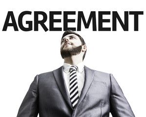 Business man pointing the text: Agreement
