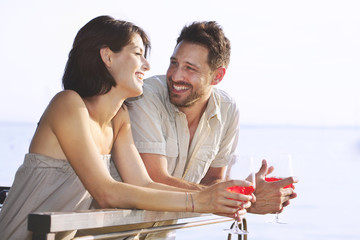 Couple having a spritz time with a lake view