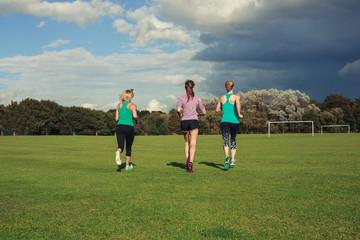 Three women running in the park