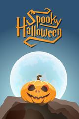Spooky Halloween pumpkin in moon light on a rock