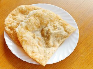 cheburek pie on white plate