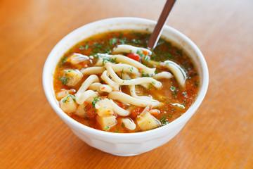 lagman soup in white bowl