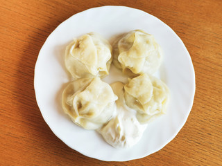 top view of manti dumpling on white plate