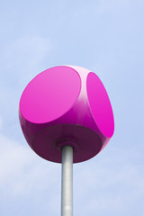 Magenta cube with rounded edges with copy space