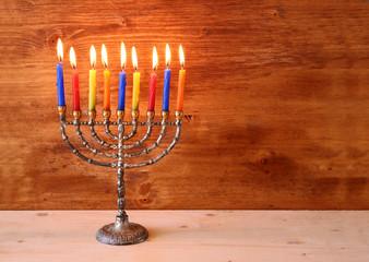 low key image of jewish holiday Hanukkah background with menorah
