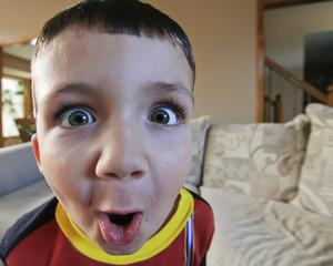 wide eyed goofy little boy