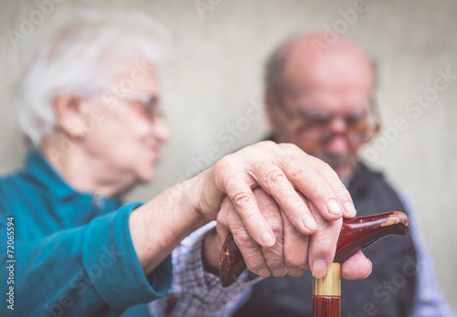 old couple holding hands - 72065594