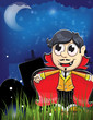 Vampire boy in the night cemetery
