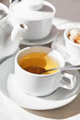 tea set and white cup with herbal tea