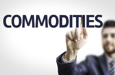 Business man pointing the text: Commodities