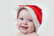 child wearing red Christmas cap, isolated over white
