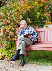 Old man reading book
