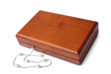 Wooden box with pearl necklace