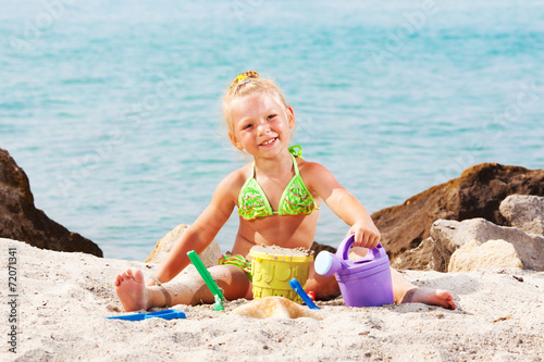 canvas print picture Little girl playing on the beach
